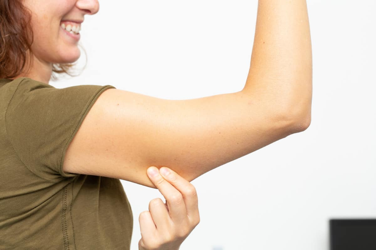 excess skin on lower arms